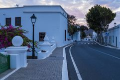 Yaiza, Lanzarote, Canary islands, Spain. Small village Yaiza in Lanzarote island, white houses and palms at volcatic background. Canary islands, Spain royalty free stock photos