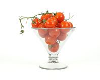 Small vine tomatoes in a large glass Royalty Free Stock Images