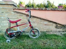 Small vintage bike. In a garden Royalty Free Stock Image