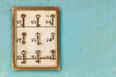 Small vintage cabinet with rusted hotel keys and room numbers Royalty Free Stock Photography