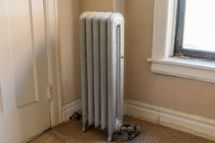 Vintage Radiator Beside a Window in an Old American Apartment Building royalty free stock image