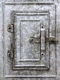 Small vintage tin door in grunge style Stock Images