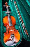 Small violin with bow in green velvet case Stock Images