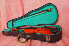 Small violin in case Royalty Free Stock Photos