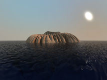 Small volcano at sea. Small volcano surrounded by water Royalty Free Stock Images