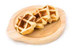 Small waffle on the wood dish. 3 pieces of small waffle are arrange on the wood dish Royalty Free Stock Image