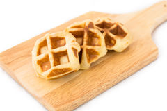 Small waffle on the wood plate. 3 pieces of small waffle are arrange on the wood plate stock photo