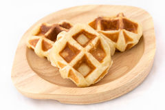 Small waffles on wood dish. Small waffles made by homemade on wooden dish Royalty Free Stock Photo