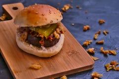 Small wagyu hamburger and fried onions stock photo