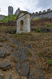 Small wall with arch and gable. Near the fort wall constructed of stones Stock Photo