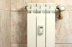 Small wall heater. Small heater with cost allocator on white heater Stock Image