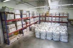 Small warehouse with lot of big white sacks Stock Photos