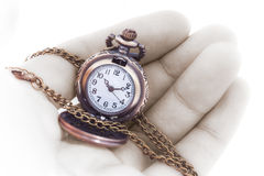 Small watch with chain in human hand Stock Photos