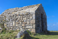 Small watch house. Small ancient rocky watch house in france Stock Image