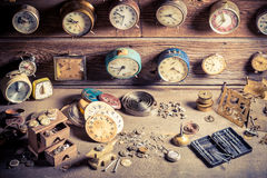 Small watchmaker's workshop with clocks to repair Stock Photos