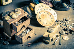 Small watchmaker's workshop with damaged clocks Royalty Free Stock Photography