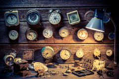 Small watchmaker's workshop full of clocks Royalty Free Stock Images