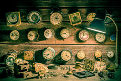 Small watchmaker's workshop with many clocks Royalty Free Stock Photo