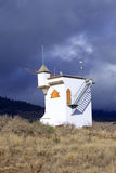 Small Watchtower with dark clouds Stock Image