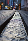 Small water canals in the streets in Freiburg, Germany. With lights Royalty Free Stock Images
