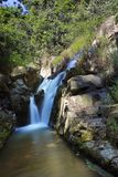 Small water fall in the forest with magic of light and long exposure part 2 stock photo