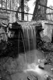 Small water spring. Black and white capture of a small water spring in a park Royalty Free Stock Photos