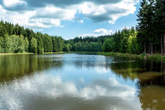Small water water reservoir. With blue sky Royalty Free Stock Photo