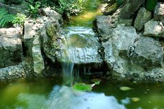 Small waterfall. Pond in Polish botanic garden in the south of the country stock images