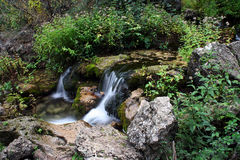 Small waterfall. Long exposure of a small waterfall near of the mundo river source Stock Photography