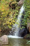Small Waterfall. A waterfall from a rock cliff in the vertical format Royalty Free Stock Photo