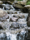 Small waterfall. With lots of rocks in shallow water Stock Photography