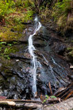Small waterfall along the trail Royalty Free Stock Photography