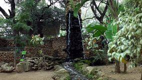 Small waterfall. Small artificial waterfall inside park stock video footage