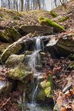 A small waterfall in autumn forest Stock Photo