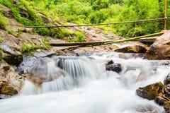 Small waterfall and bamboo bridge in rain forest. Umpang, Thailand Stock Image
