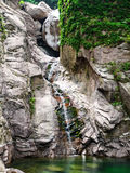 Small waterfall on beautiful rock Stock Photos