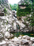 Small waterfall on beautiful rock Stock Images