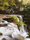 Small waterfall with bicycle Royalty Free Stock Images