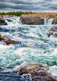 Small waterfall with big stone Stock Images