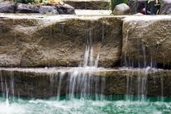 Small waterfall cascading Royalty Free Stock Image