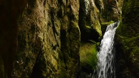 Small waterfall in a cave Stock Image