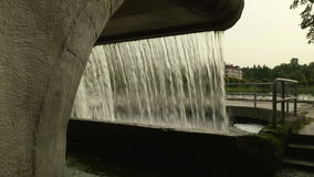 Small waterfall in the city. Autumn daytime. Smooth dolly shot.  stock footage