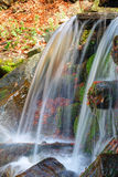Small waterfall with clean water. From the woods Royalty Free Stock Photos