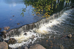 Small Waterfall in Clear Lake Stock Image