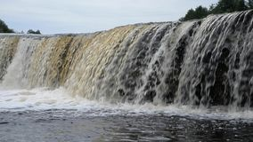 Small waterfall at cloud day. stock footage