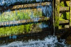 Small waterfall in countryside. Nature in latvia Stock Image