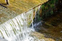Small waterfall in countryside. Nature in latvia Stock Images