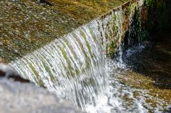 Small waterfall in countryside. Nature in latvia Royalty Free Stock Photos