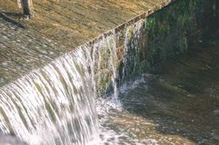 Small waterfall in countryside - vintage film look. Small waterfall in countryside. nature in latvia - vintage film look Royalty Free Stock Images