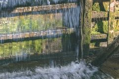 Small waterfall in countryside - vintage film look. Small waterfall in countryside. nature in latvia - vintage film look Stock Image